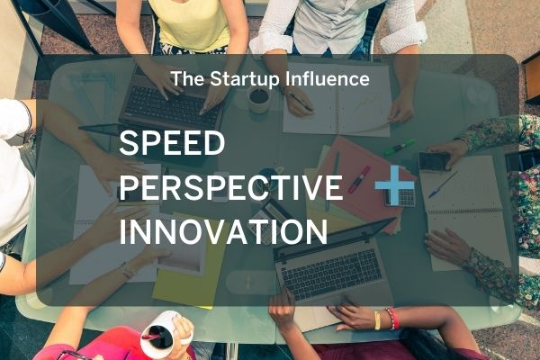 The startup influence? Speed, perspective, and innovation. Photo of entrepreneurs sitting around a table working.
