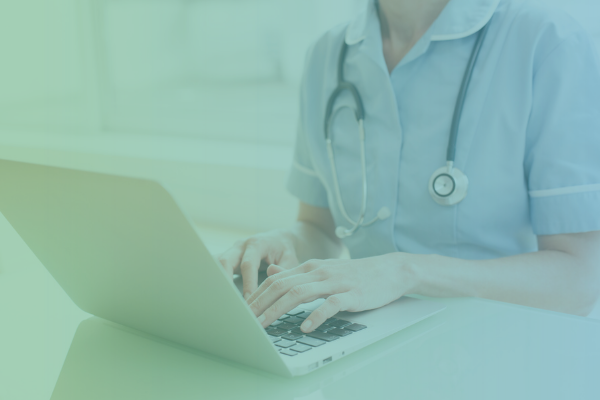 Physician using computer to access telehealth